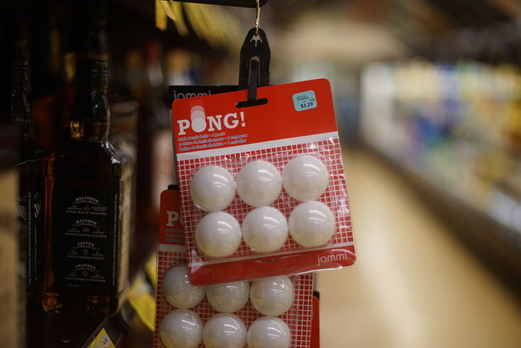 ping pong balls hanging in grocery store Beer Pong Close-up Day Depth Of Field Food Freshness Hanging Indoors  No People Party Ping Pong Price Tag Retail  Store Text