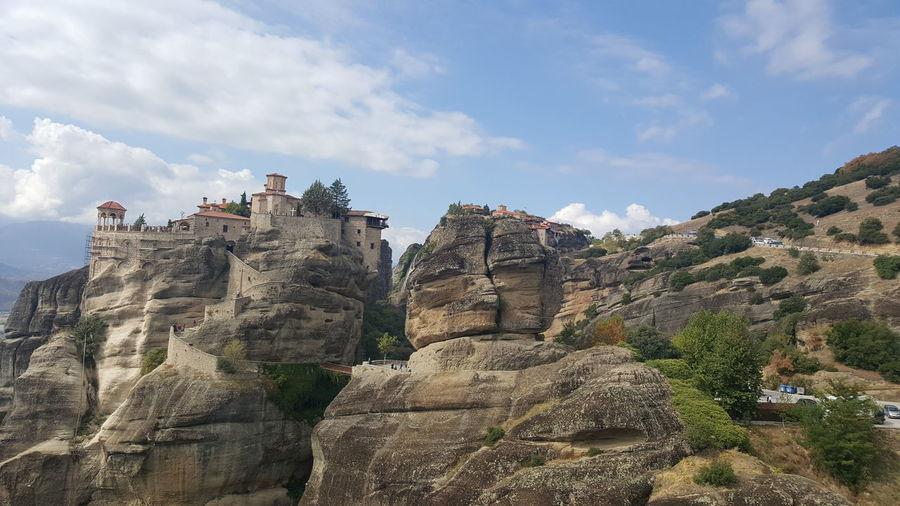 Castle on cliff against sky