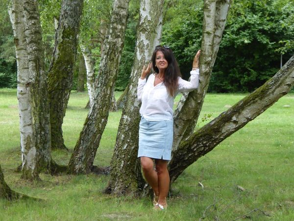 Long Hair One Person Tree Beautiful Woman Young Adult Your Ticket To Europe Investing In Quality Of Life The Week Of Eyeem The Great Outdoors - 2017 EyeEm Awards EyeEm Best Shots Day Smiling Barefoot Full Length Nature Front View Tree Trunk Happiness Young Women Relaxation Leisure Activity Beauty Green Color Real People Only Women
