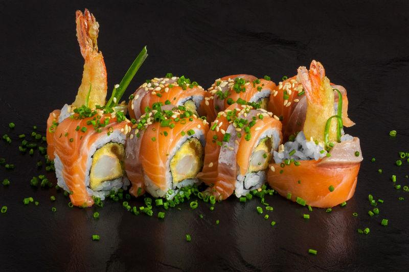 Close-up of sushi on black background
