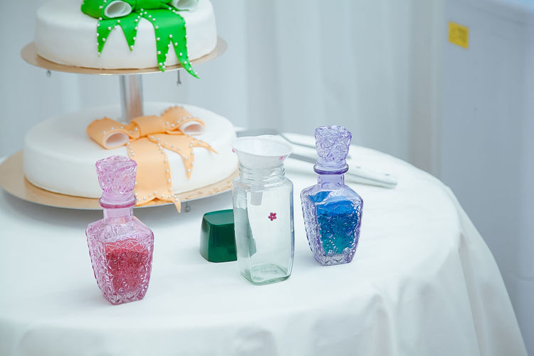 Wedding cake and objects on table