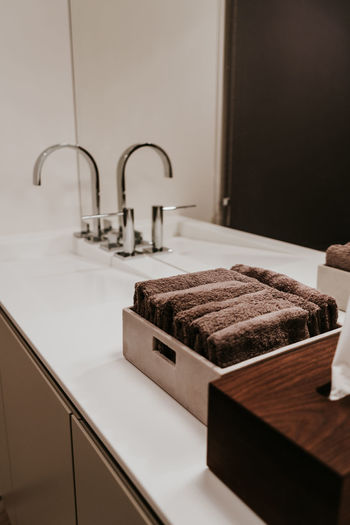 Indoors  Home Domestic Room Home Interior No People Luxury Food And Drink Hygiene Faucet Wealth Still Life Towel Sink Household Equipment Home Showcase Interior Modern Table Furniture Kitchen Close-up Tray