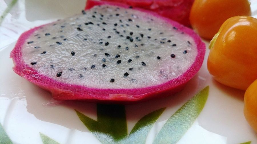 Close-Up Of Pitaya Slice In Plate