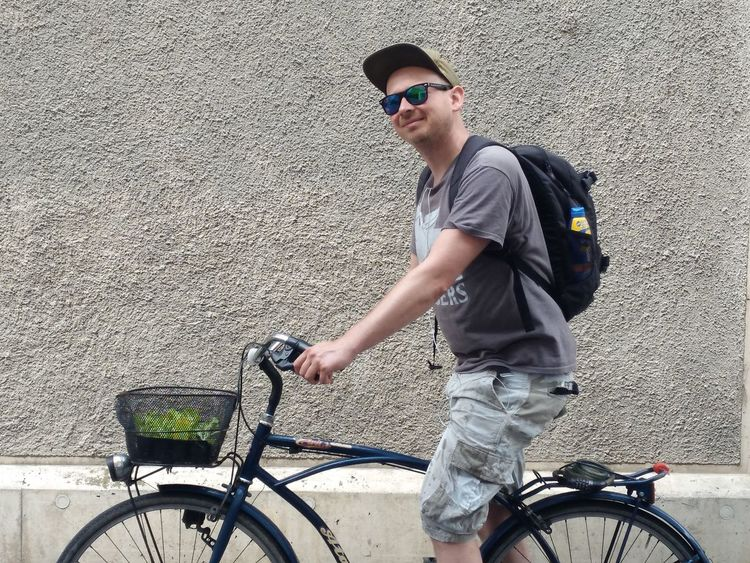 EyeEm Selects Bicycle Sunglasses Young Adult One Person One Man Only Casual Clothing Only Men Cycling Transportation Young Men One Young Man Only Adults Only Adult Standing People Day Lifestyles Outdoors