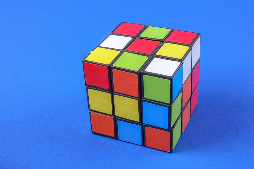 RUBIK'S CUBE , CREATIVITY TOY Creativity Rubik Cube Block Blue Blue Background Close-up Colored Background Copy Space Cube Shape Design Geometric Shape Indoors  Intelligence Multi Colored No People Puzzle  Rubik Shape Still Life Studio Shot Toy Toy Block Wood - Material