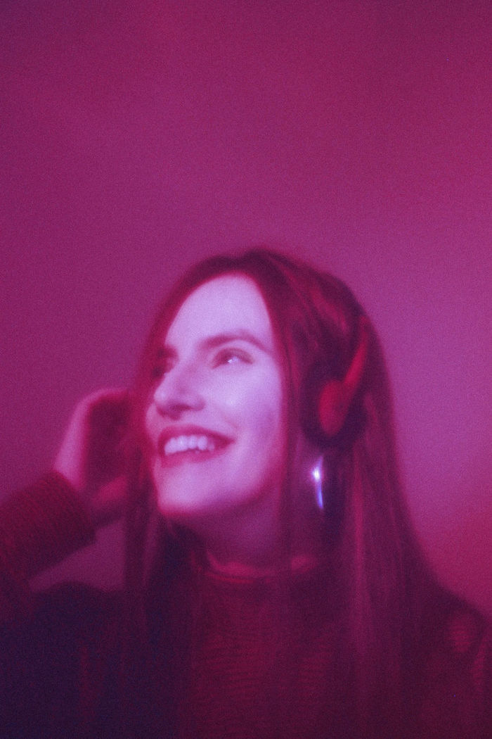 Smiling young woman wearing headphones