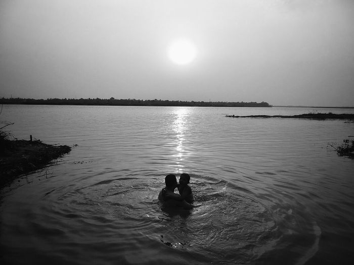 A dip for an evening bath in the holy river! Silhouette Blackandwhite Black & White River Family Family❤ India Mayapur Check This Out Enjoying Life