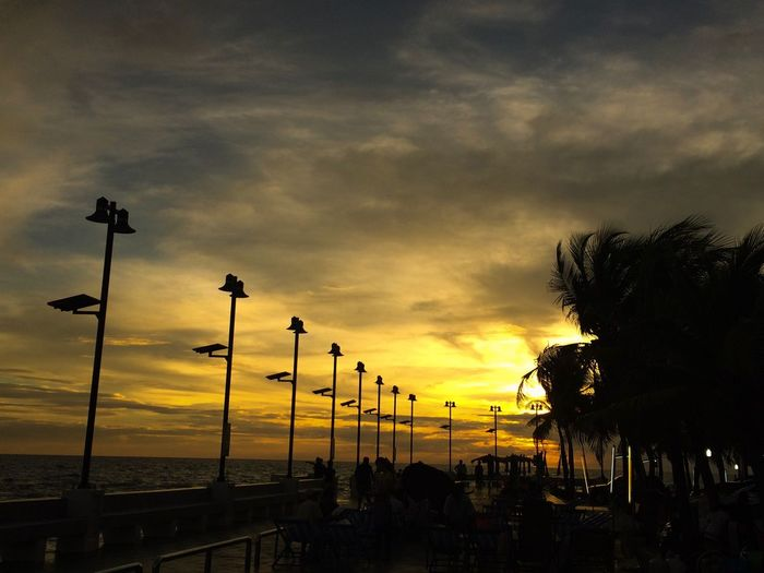 Cloud - Sky Sunset Sky Silhouette Dramatic Sky Street Light Nature Outdoors Beauty In Nature Palm Tree Scenics No People Tree Travel Destinations Sea Love Sea Dinner Time An Eye For Travel