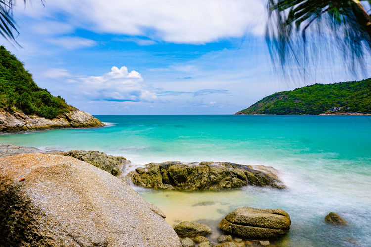 Seascape rock coast in summer. at coast phuket thailand Water Sky Sea Beauty In Nature Scenics - Nature Cloud - Sky Rock Land Beach Tranquil Scene Tranquility Rock - Object Solid Nature Idyllic Tree Day No People Horizon Over Water Outdoors Turquoise Colored