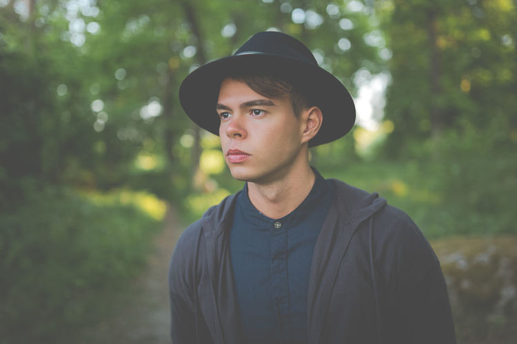 Awesome portret of man in hat at the forest