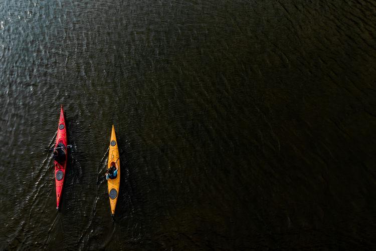 Aerial view of people kayaking in sea