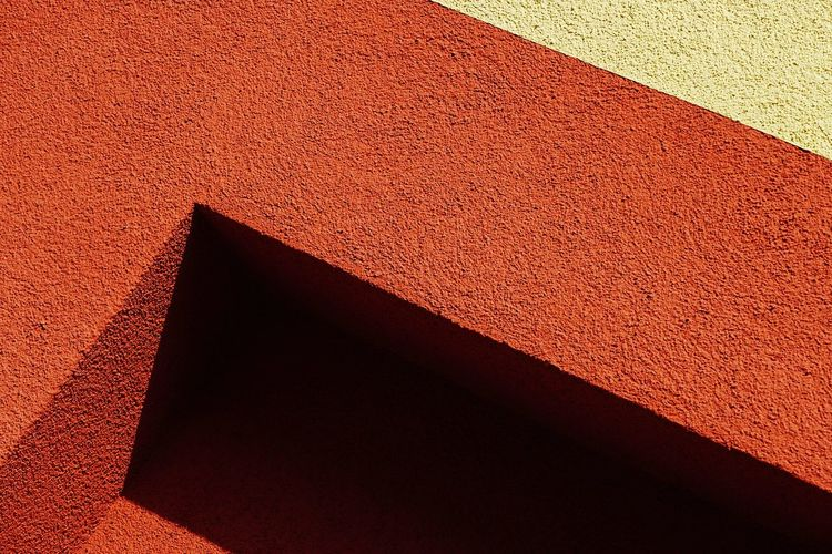 High angle view of red shadow on wall