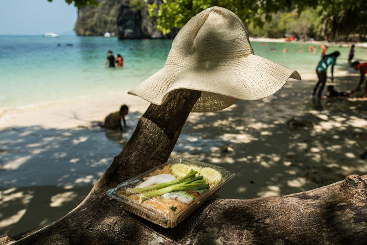 Beauty In Nature Close-up Day Fire Rice Focus On Foreground Hat Idyllic Nature No People Outdoors Rock Rock - Object Scenics Shore Sunny Tranquil Scene Tranquility Water