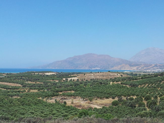 Blue Sea Landscape Scenics Beach Clear Sky Beauty In Nature Nature Mountain Outdoors Tranquil Scene No People Sky Day Horizon Over Water Grass Water Crete Komos Beach Matala