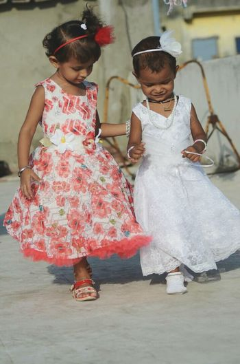 Two sweethearts Two People Smiling Girls Full Length Child Day Children Children Photography Princess Cute Baby Girls Birthday Walking Girls Whitedress Red Dress ♡ Angels