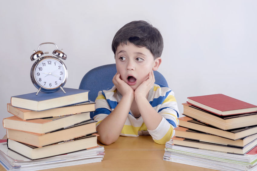 Learning Read Reading Stress Unhappy Back To School Book Boredom Boring Childhood Classroom Clock Education Examine Expression Intelligence Learning Sad Schoolboy Stressed Studying Surprise Text Book