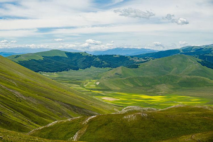Scenic view of landscape against sky in castelluccio, umbria
