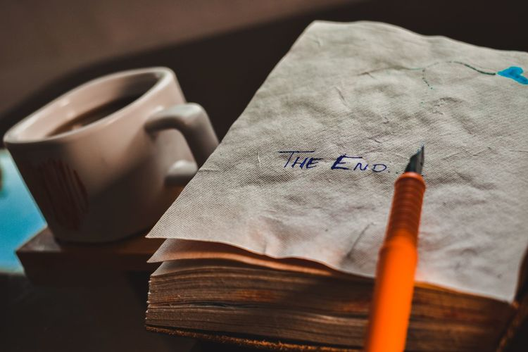 Close-up of pen with text in tissues