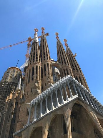 EyeEm Selects Low Angle View Architecture Built Structure Religion Spirituality Building Exterior Day History Place Of Worship Sky Outdoors Travel Destinations Blue No People Barcelona SPAIN Segrada Familia