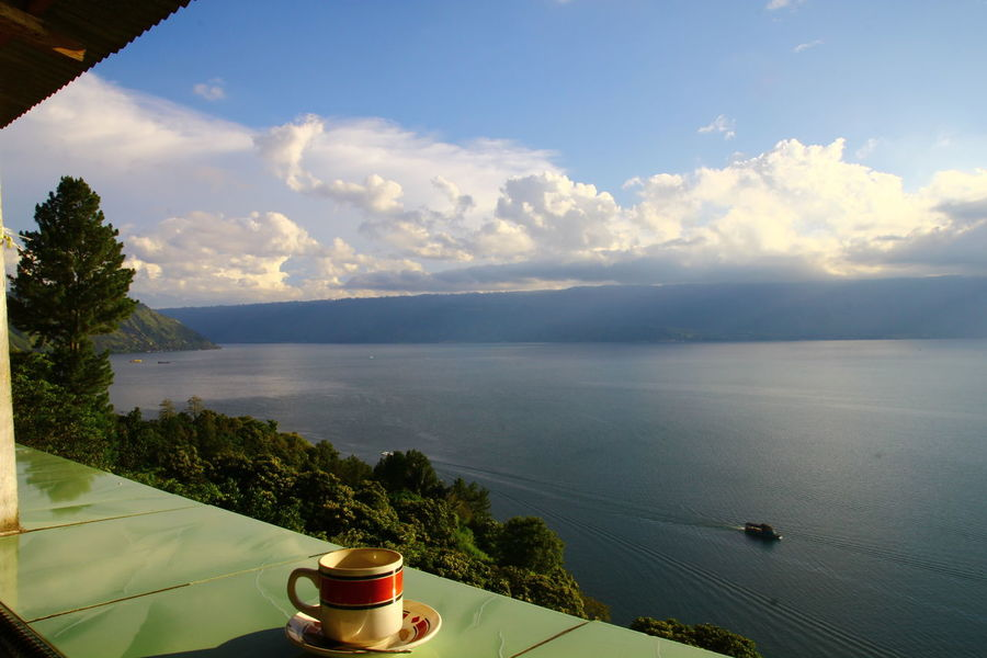afternoon coffee in the Toba lakeside. Coffee Coffee Time Coffee Cup Coffee ☕ Lake Lake View Sunset Sunset Lovers INDONESIA Travel Destinations Scenic Photograghy Scenic View Travel Photography Travel Photography By @jgawibowo Shot By Arif Wibowo EyeEm Landscape EyeEm Nature Lover Eyeem Landscape Official Photo Club📷 Water Scenics Lake High Angle View Sky Tranquility No People Mountain Beauty In Nature Landscape