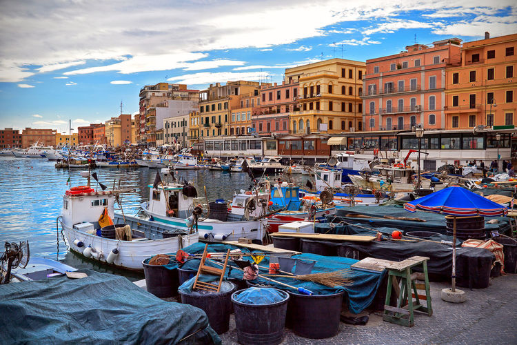 The quay of the port of Anzio, with the fishing boats and fishing nets. Landing Anzio Boats And Moorings Color Composition In Orange And Yellow Dock Fishing Fishing Fishing Harbor Italy Italy Port Portrait Sailboat Sea Seaside Sky And Clouds
