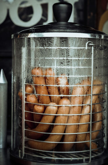 Hot sausages in condensed glass jar