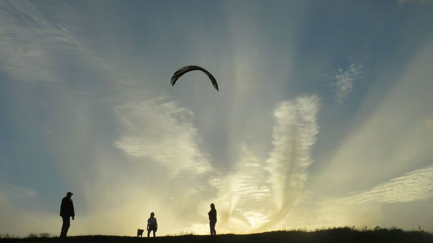 Flying People Silhouette Sky Outdoors Adult Nature Bird Day One Person Adults Only Paragliding Silhouette Sunset Ancient Civilization Leisure Activity Cloud - Sky Scenics Sunlight Low Angle View