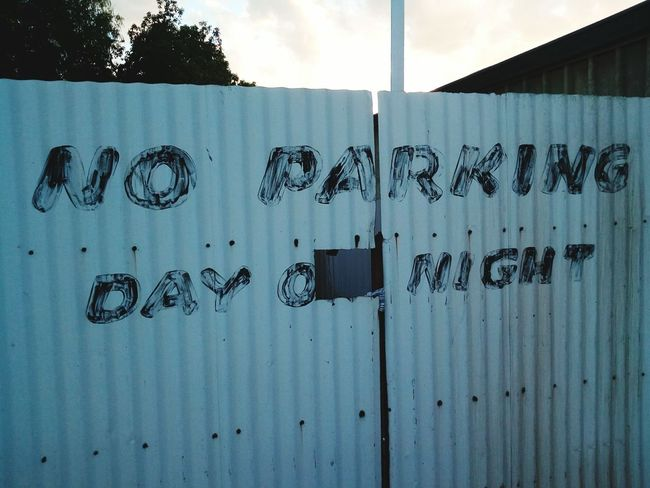 no parking Politics And Government Communication Text Graffiti Sky Architecture Close-up Building Exterior Built Structure Spray Paint Street Art Vandalism Spray Bottle Written Aerosol Can Handwriting  Paint Can Information No Parking Sign
