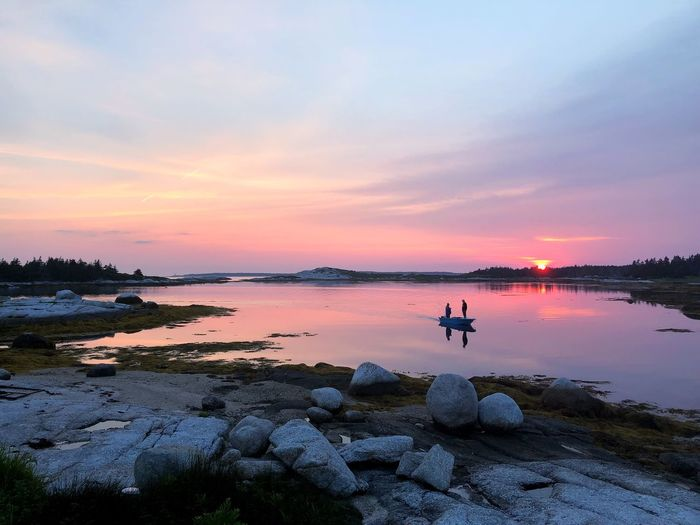 Nova Scotia Landscape Boat Fisherman Nova Scotia Water Sunset Sky Beauty In Nature Scenics - Nature Orange Color Tranquility Sea Real People Cloud - Sky Tranquil Scene Reflection Beach Land Non-urban Scene Lifestyles Outdoors