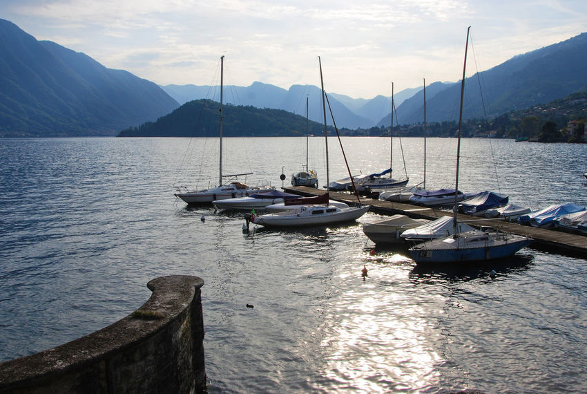 Sun is falling down - Tremezzina, Como, Italy. Italia Lario Lombardy Marina Tremezzo Beauty In Nature Europe Italian Italy Lake Lakeside Lombardia Mode Of Transport Moored Nature Nautical Vessel Outdoors Scenics Sky Tourism Transportation Travel Destinations Tremezzina Water