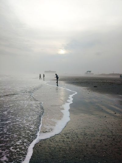 Foggy Day Premium Collection Shades Of Winter Full Length Beach Reflection People Landscape Water Day Outdoors Sky Low Tide Sunset Salt - Mineral Sea