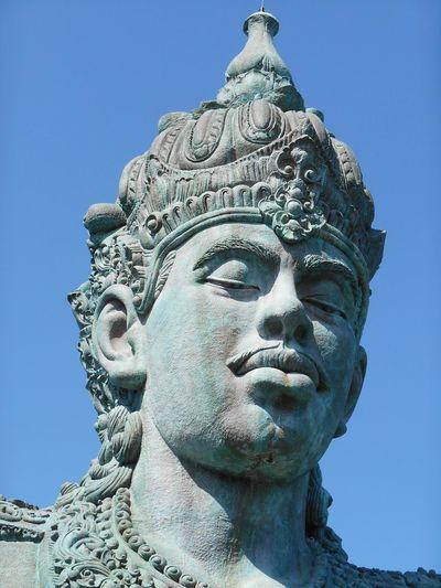 Low angle view of vishnu statue at garuda wisnu kencana against sky