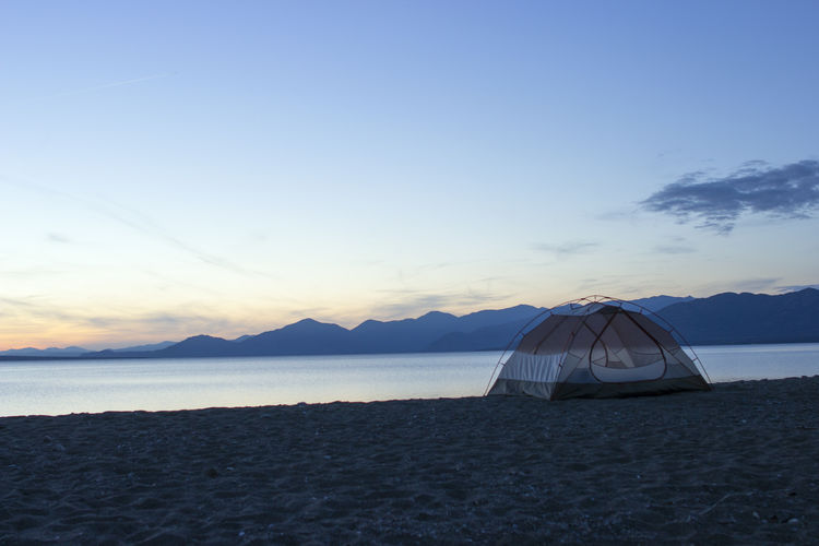 Tent on beach against sky Camping Suset View Beach Beach Camping Beauty In Nature Camp Cloud - Sky Day Idyllic Land Mountain Nature No People Non-urban Scene Outdoors Sand Scenics - Nature Sea Sky Sunset Tent Tent On Beach Tranquil Scene Tranquility Water