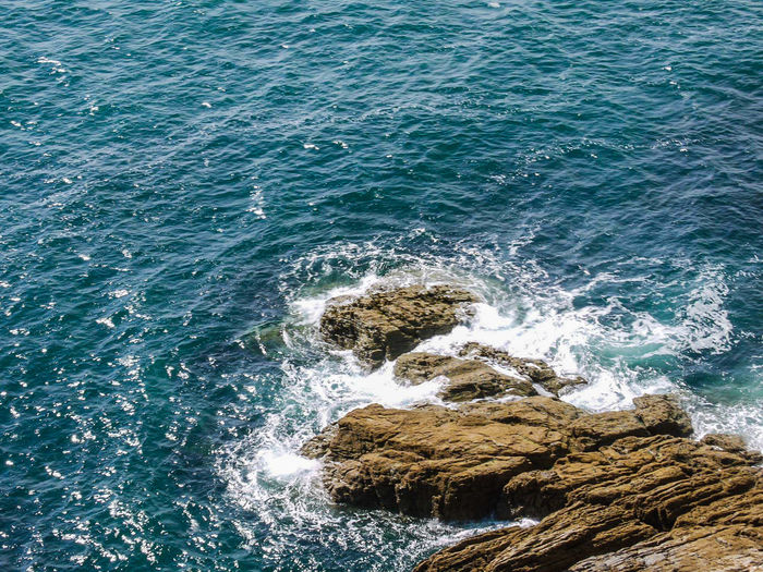 Scenic view of sea by rock formation