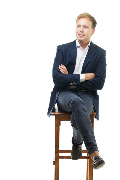 Blond Businessman Businesspeople Caucasian Chair Formal Gaze Handsome Isolated Male Man Studio Vertical White Wooden