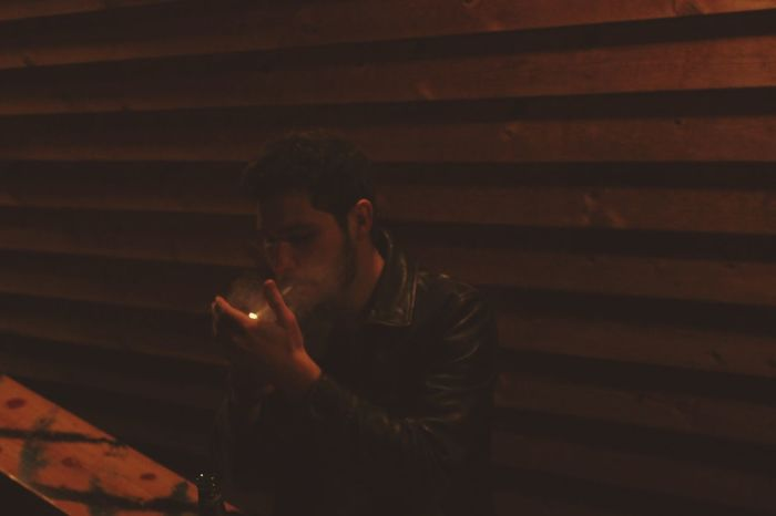 One Man Only One Person Only Men One Young Man Only Night Outdoors Smoking Smoking Cigarettes. Dunhill Cigarettes Leather Jacket Pub Zippo Lighter Firelight Me In The Photo