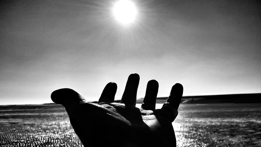 The Touch of Sunrays on my cold hands.. Bnw_friday_eyeemchallenge Fortheloveofblackandwhite Black And White EyeEm Best Shots - Black + White Beachphotography Life's A Beach My Island Let's Go. Together. Perspectives On Nature