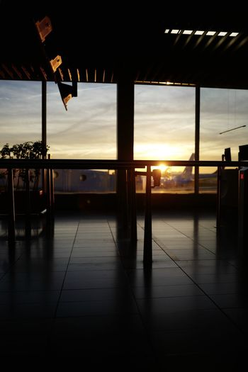 Sky Sunset Indoors  Window Glass - Material No People Cloud - Sky Architecture Flooring Nature Transparent Reflection Seat Sunlight Silhouette Built Structure Airport Absence Tiled Floor Glass Ceiling
