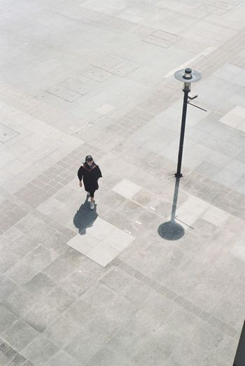 High angle view of man standing on floor