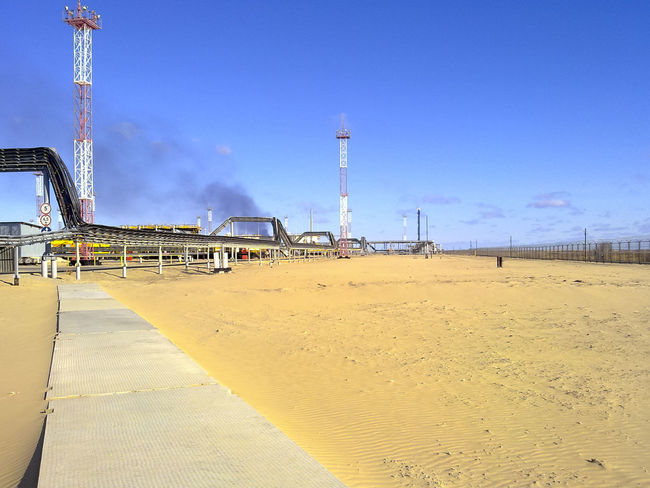 Oil Oil Pump Gas Gasprom Rosneft Refinery Industry Sky Nature Land Day Built Structure Architecture Fuel And Power Generation Outdoors Sand Factory Oil Industry Sunlight Blue No People Clear Sky Environment Metal Development Industrial Equipment Oil Well