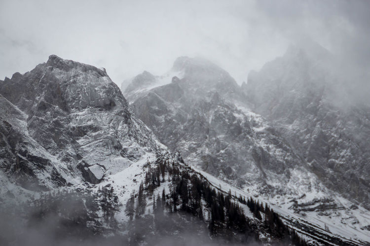 Mountain Cold Temperature Winter Beauty In Nature Mountain Range Snow Environment Scenics - Nature Nature Tranquil Scene Landscape Fog Sky Tranquility No People Day Non-urban Scene Cloud - Sky Mountain Peak Outdoors Snowcapped Mountain Snowing Formation