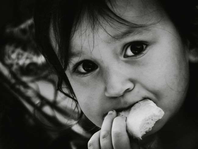 Thank God, I can eat! Little Girl Portrait Of Innocence Portrait EyeEm Best Shots - People + Portrait EyeEm Best Shots - Macro / Up Close EyeEm Best Shots - Black + White Dirty Nails Untold Stories Capture The Moment Photos That Will Restore Your Faith In Humanity Monochrome Photography