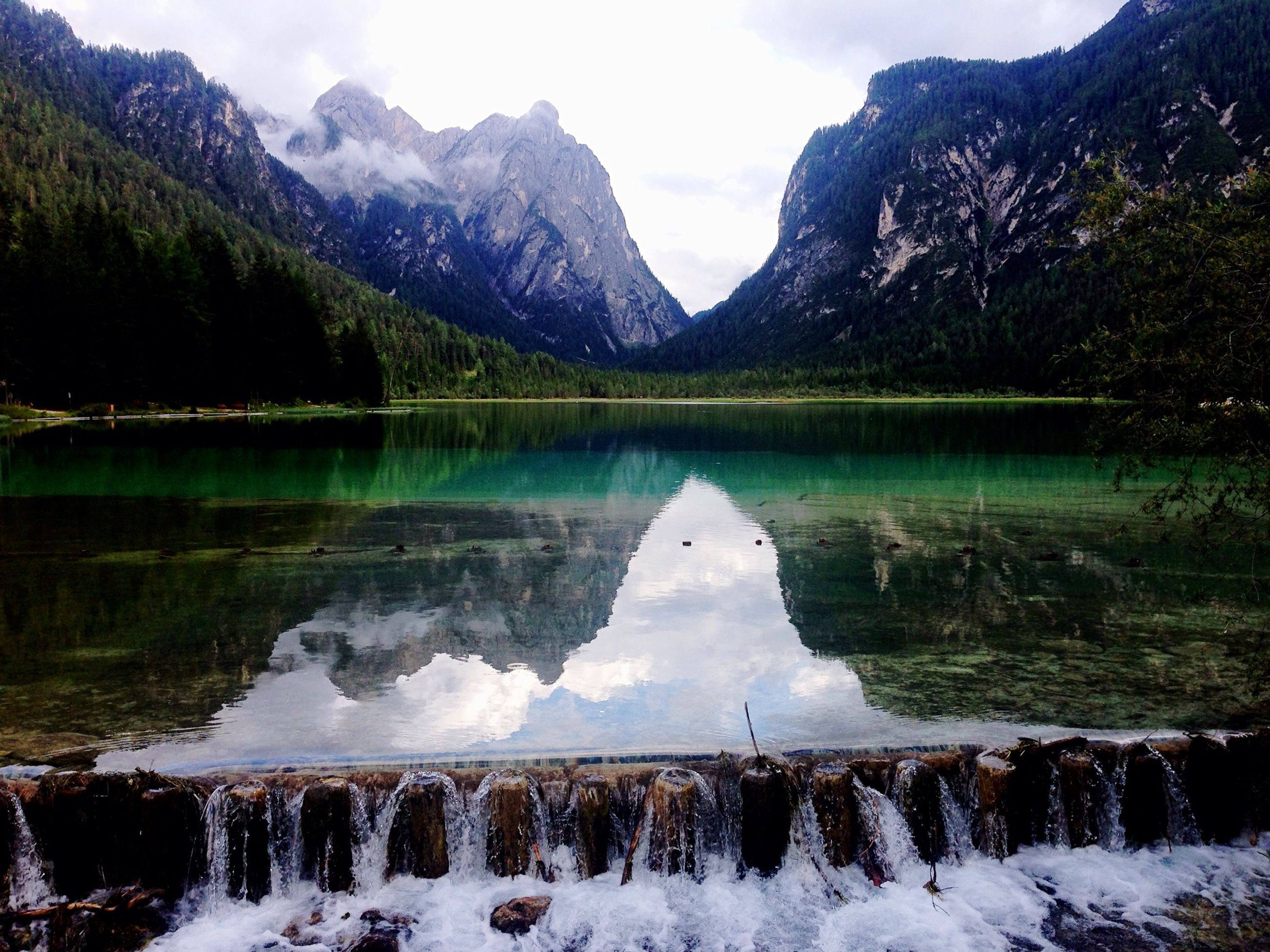 mountain, snow, winter, cold temperature, tranquil scene, scenics, mountain range, water, tranquility, beauty in nature, lake, season, snowcapped mountain, reflection, nature, weather, sky, frozen, non-urban scene, idyllic