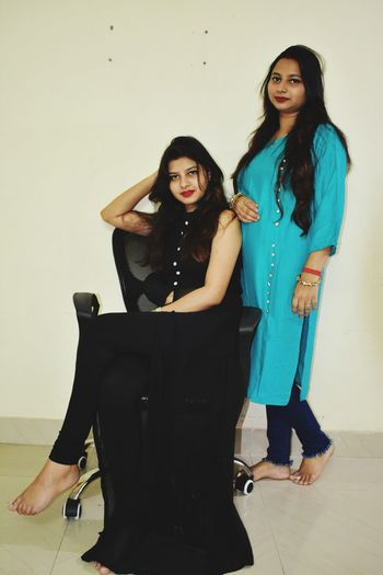 Combination of blue and black Human Connection Friendship Young Women Standing Full Length Long Hair Friend Fashion Model