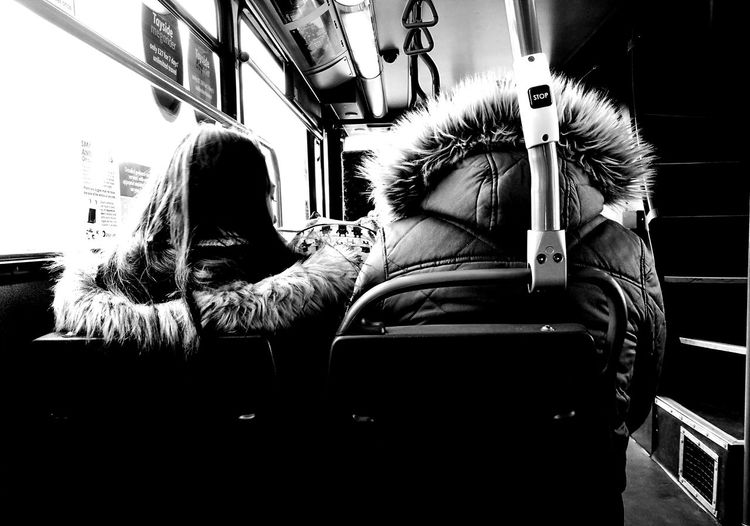 Rear view of two people on seat