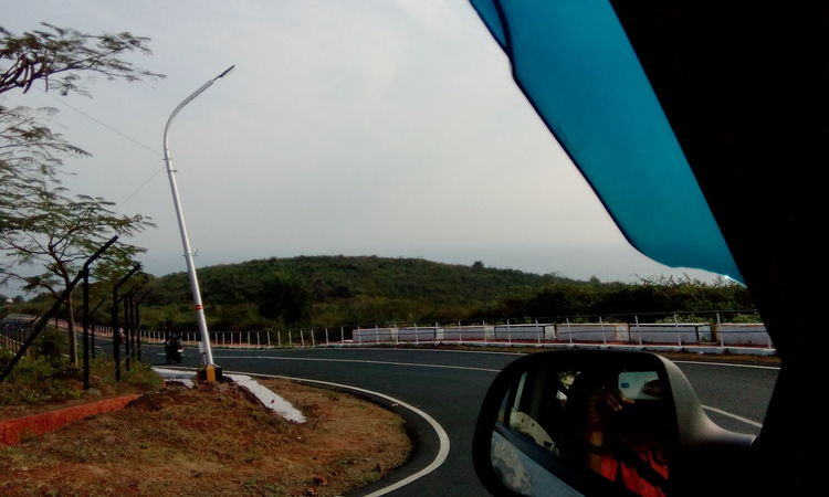 Photography In Motion Banked Curve Goingto Rushikonda by Car Nice Day Road Eyeem Best Shots In Motion The Way Forward Going On Fun Capture The Moment A Long Way Street Day Green Hill My Commute