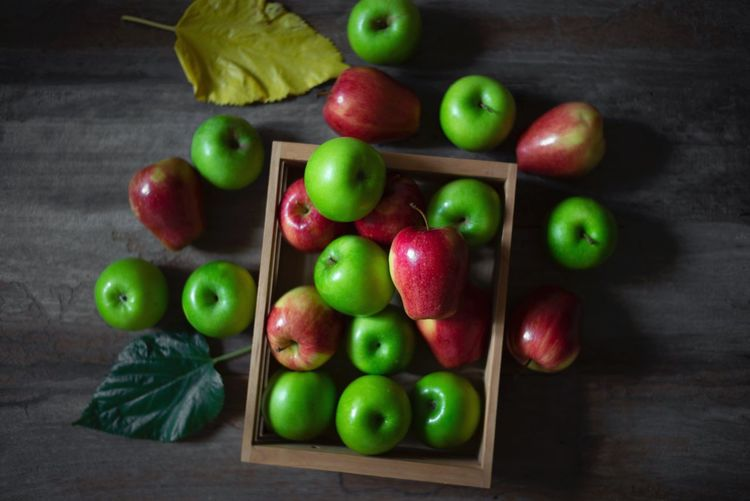 Apple on wood Food Food And Drink Healthy Eating Freshness Fruit Wellbeing Still Life Table Green Color Indoors  Close-up Red Wood - Material Apple - Fruit High Angle View No People Choice