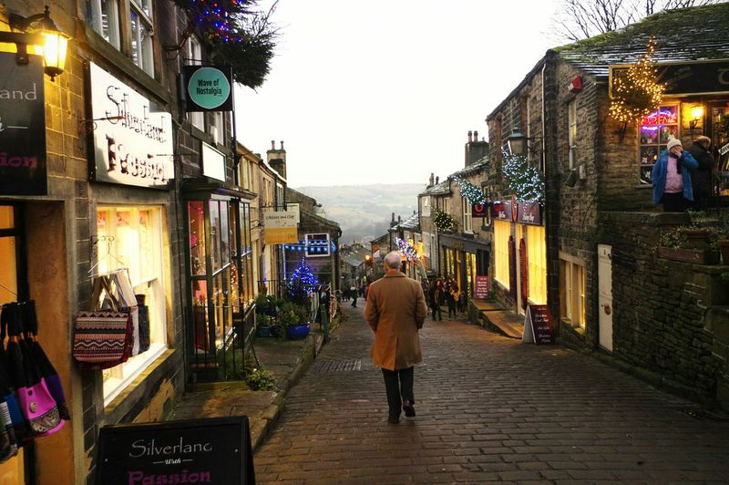 Street One Man Only Built Structure Outdoors Travel Destinations Architecture People Bronte Christmas Around The World Cobbles Retail  Haworth Tourist Attraction  Yorkshire Shopping Time Winter Giftshop Christmas Architecture The Way Forward Christmas Decorations Building Exterior Townscapes For Sale