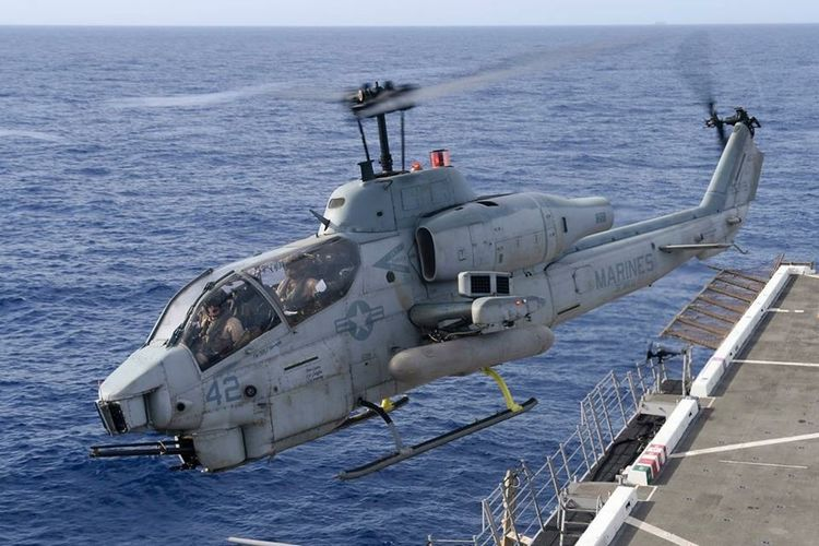 U.S Marine Corps AH1 Cobra attack helicopter flying off an Amphibious assault ship USA Us Military USMC Cobra Helicopter