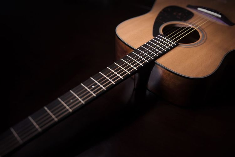 Close-up of guitar on black background